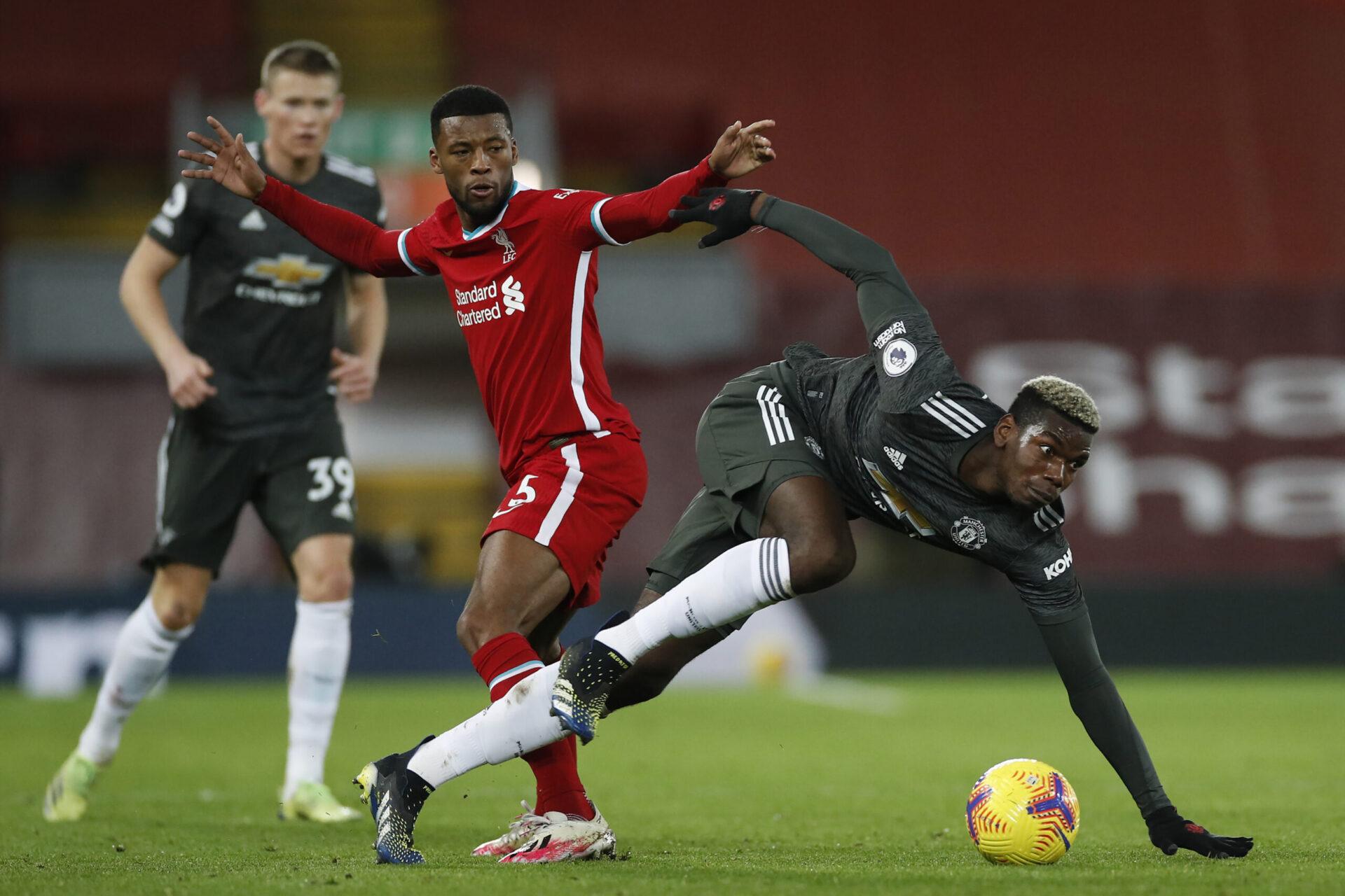 Giorginio Wijnaldum et Paul Pogba en duel lors d'une rencontre de Premier League (iconsport)