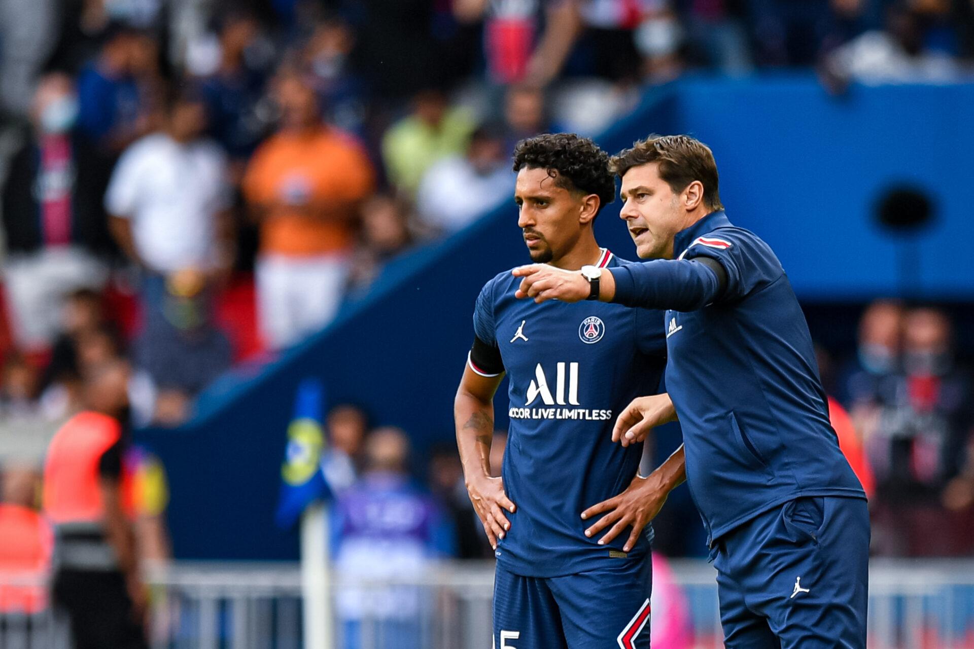 Pochettino (à droite) qui donne des conseils à son capitaine Marquinhos (à gauche) (iconsport)